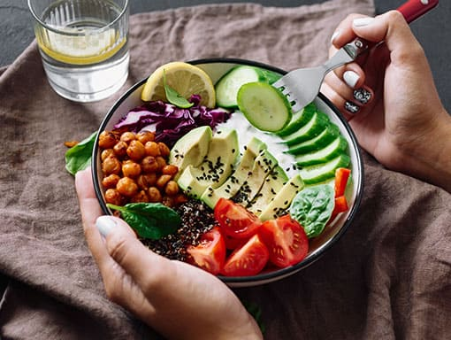 Photo of Salad in Bowl with Tomatoes and Cucumber
