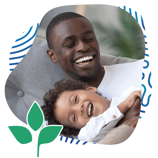 Portrait of Happy Smiling Afro-American Family of Dad and Son Playing on the Couch